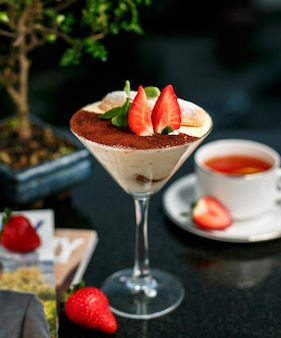 Tiramisu with strawberry on the table