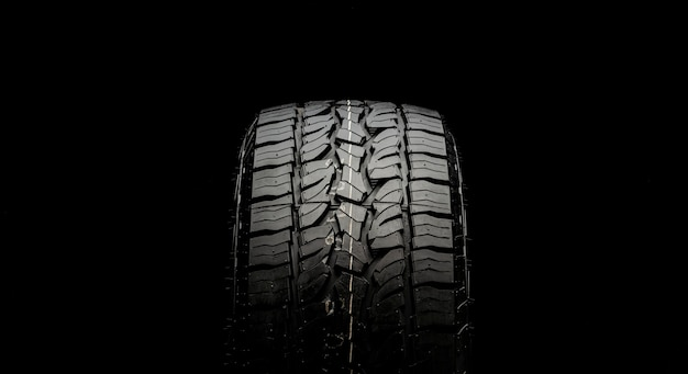 Tire for suvs and crossovers with powerful checkers and grapples close-up on a black background.