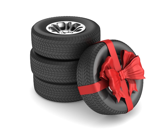 Tire with red bow on white space