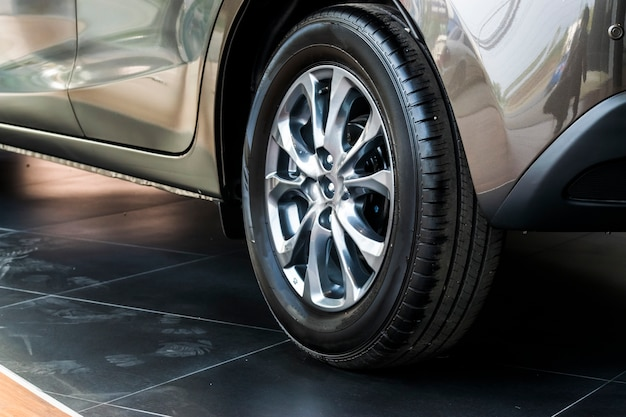 Tire with suspension car on street. using wallpaper or background for transport and automo