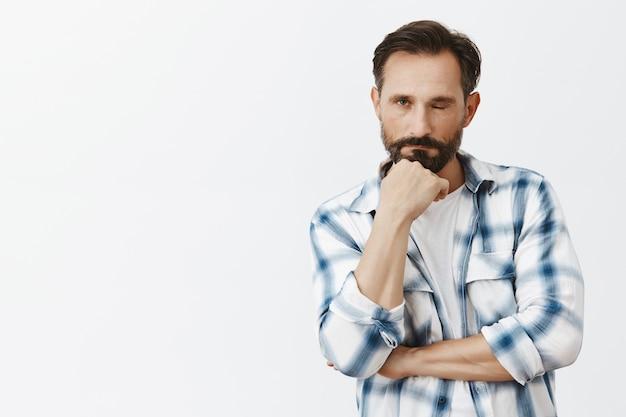 Tired bearded mature man posing