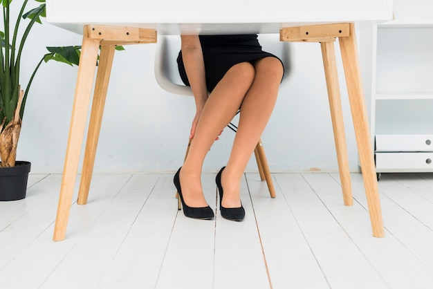 Tired business woman sitting at table