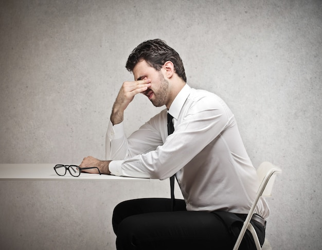 Tired businessman having difficulties
