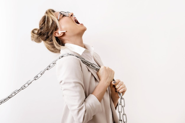Tired businesswoman is pulling the chains. concepts of debts or hardness of job promotion for women.