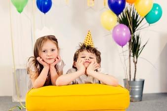 Tired children on birthday party