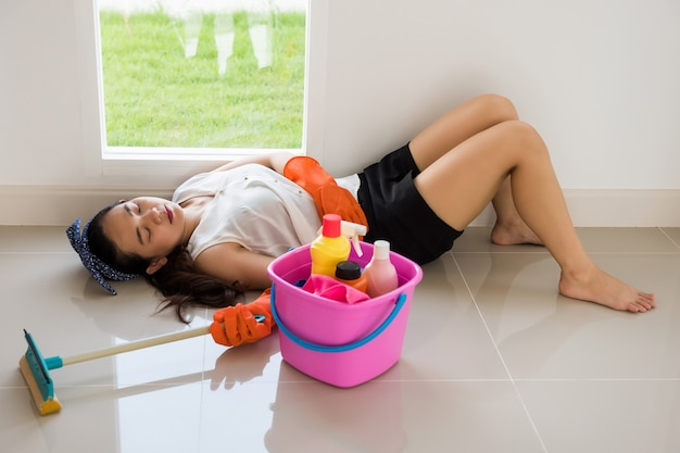 Tired female owner sleep after cleansing house
