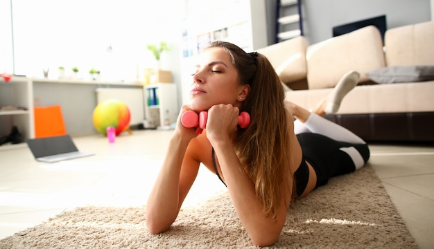 Tired female woman exercising at home