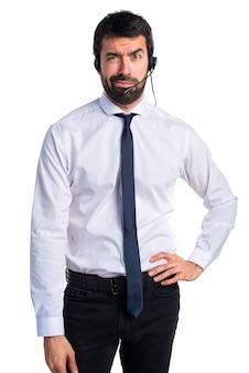 Tired handsome telemarketer man