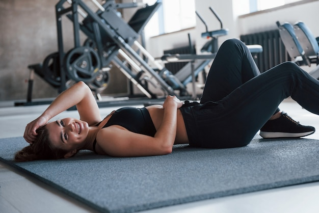 Tired a little. photo of gorgeous blonde woman in the gym at her weekend time