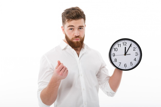 Tired man in business clothes showing time is money gesture