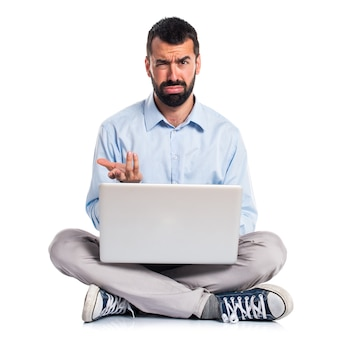 Tired man with laptop