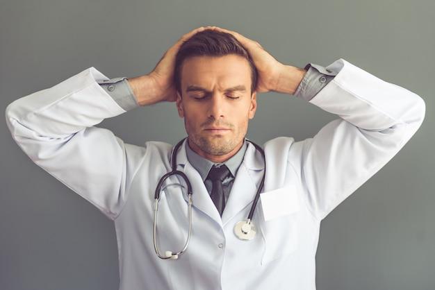Tired medical doctor in white coat