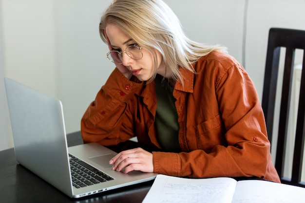 Tired woman developer working with computer at home office