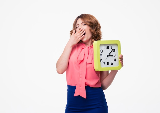 時計を保持している疲れた女性