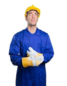 Tired workman on white background