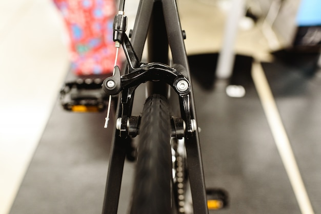 Tires and rear brake of a road bike.