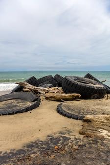 Tires on the tropical sandy beach