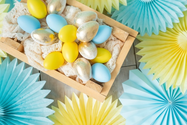 Tissue paper decorations fans, and wooden box with eggs