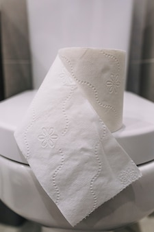 Tissue paper on toilet seat