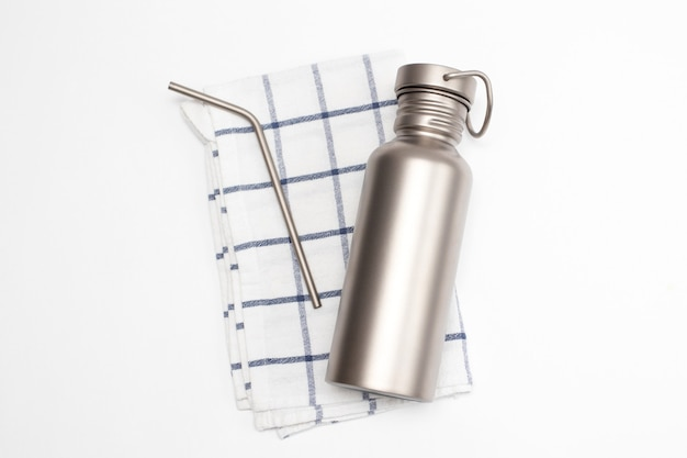 Titanium hydration bottle and reusable stainless steel straws. zero waste concept