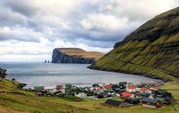 Tjornuvik village and two sea stacks on faroe islands
