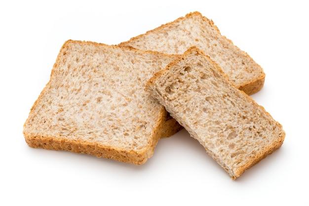白い表面に分離されたトーストパン。