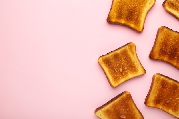 Toast bread on a pink background. top view, flat lay
