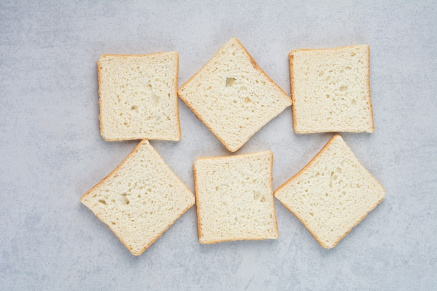 Toast bread slices on marble background. high quality photo