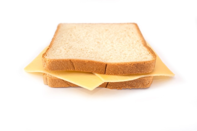 Toast bread with hard cheese on a white plate. slice of white bread with cheese