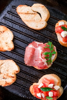 Toast on grill pan set of crostini