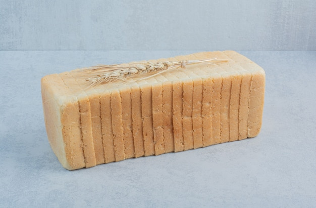 Toast wheat bread slices on blue background. high quality photo