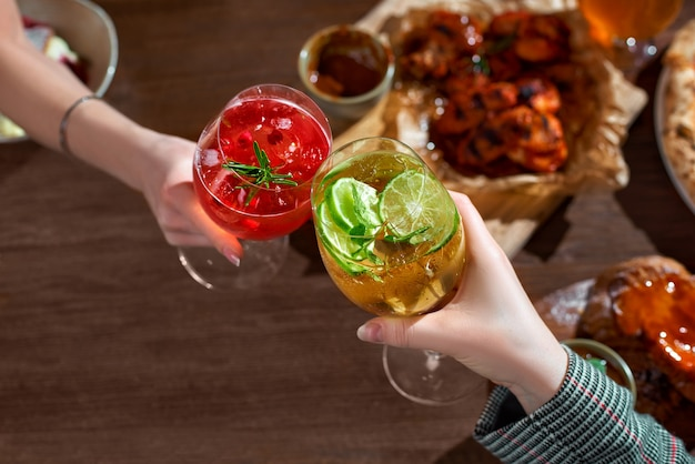 Toast with aperol spritz coctails in hends