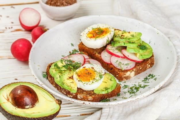 Toast with avocado, radish, egg and flax seeds