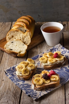 Toast with bananas and forest fruits