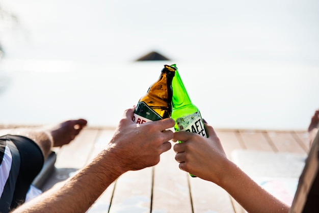 A toast with beer bottles
