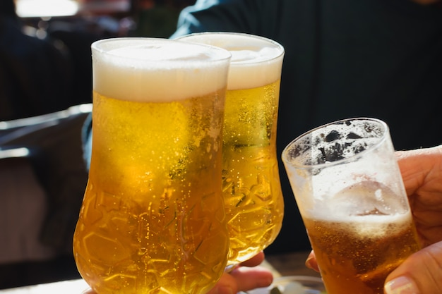 Toast with beer. draft pints.