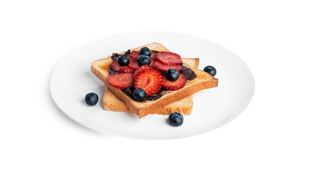 Toast with chocolate and berries isolated on white.