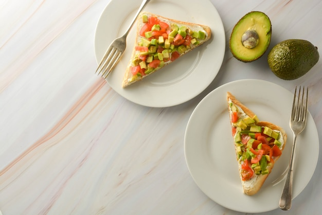 Toast with cream cheese, avocado and cherry tomatoes. healthy food. copy space.