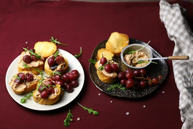Toast with goose liver pate and baked grapes.