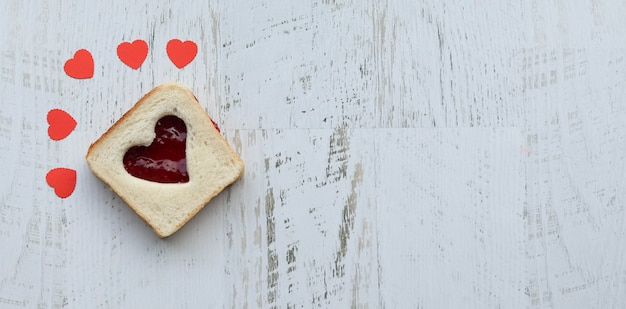 Toast with heart-shaped and strawberry jam