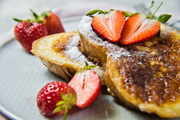 Toast with strawberries and maple syrup.