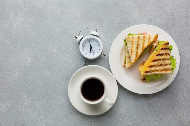 Toasted bread and alarm clock