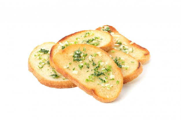 Toasted bread slices with garlic isolated on white