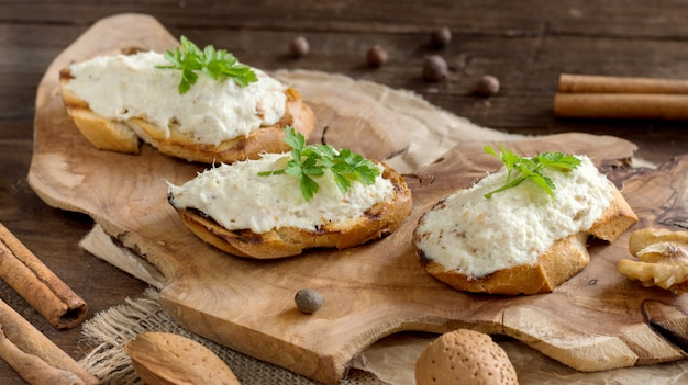 Toasted bread with a salted codfish mousse on wood close up