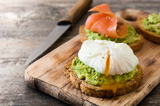 Toasted breads with poached eggs, avocado and salmon