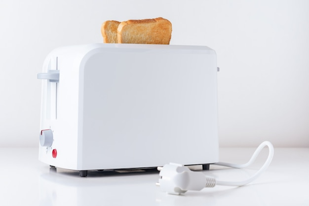 Toaster with  roasted toast bread on white