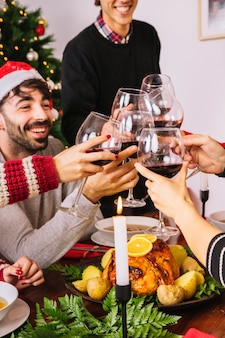 Toasting with wine at christmas dinner