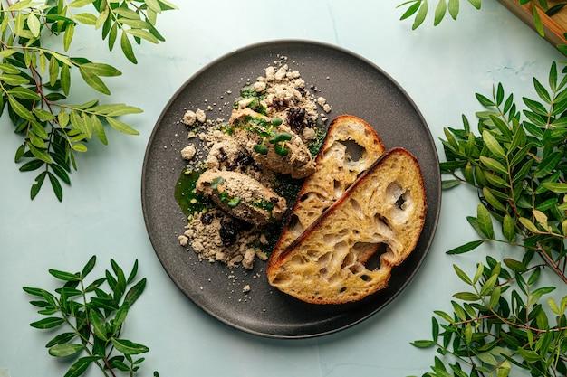 Toasts chicken liver pate with halva and prunes