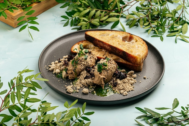 Toasts chicken liver pate with halva and prunes