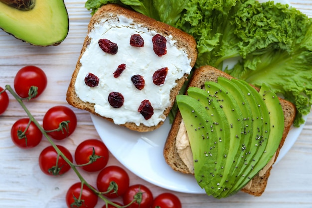 Toasts with avocado and feta cheese, top view for breakfast